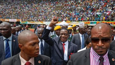 Emmerson Mnangagwa, center, arrives at his presidential inauguration ceremony last year.
