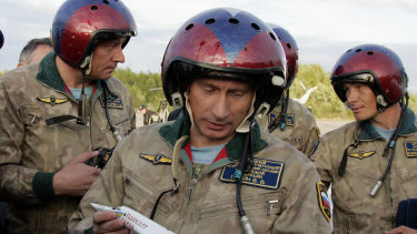 """Vladimir Putin, pictured in flying gear in 2005, faces an """"election"""" this year virtually without an opponent."""