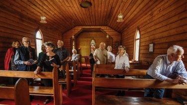 Parishioners inside St Aidan's Anglican church, Black Springs.