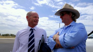 Campbell Newman chats with LNP colleague Vaughan Johnson at Emerald airport.