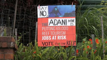 A sign protesting the proposed Adani mine is seen in South Brisbane in the lead-up to the Queensland election.