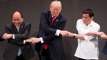 """US President Donald Trump does the """"ASEAN-way handshake"""" in Manila last year. The regional grouping is often dismissed but Wong insists it has value."""