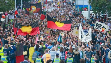 Protesters march through the streets of the Melbourne CBD at an Indigenous rally in 2015.