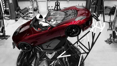 "A mannequin ""Starman"" sits at the wheel of a Tesla Roadster which was sent into space."