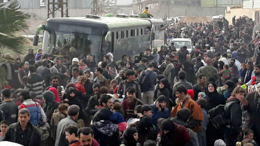 Syrian civilians flee fighting between the government forces and rebels in eastern Ghouta, a suburb of Damascus.