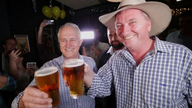 Prime Minister Malcolm Turnbull and Deputy Prime Minister celebrate on the night of the December 2 byelection.