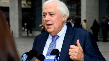 Businessman and former federal MP Clive Palmer, addresses the media at the Supreme Court, in Brisbane.