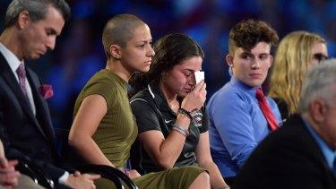 Marjory Stoneman Douglas High School student Emma Gonzalez comforts a classmate during a CNN town hall meeting on Wednesday.