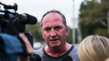 Former deputy prime minister Barnaby Joyce talks to reporters this week after playing rugby with colleagues.