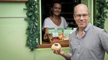 Damian Griffiths, the founder of Doughnut Time, with one of his $6 doughnuts.