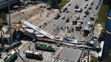A DroneBase photo shows the collapsed pedestrian bridge at Florida International University.