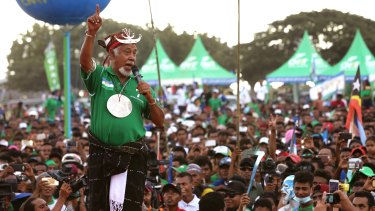 Former East Timorese president Xanana Gusmao speaks to supporters during a campaign rally in Dili in July.