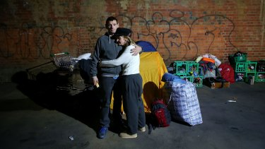 A homeless couple after they were evicted from their makeshift camp in Melbourne in June 2016.