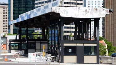 The cash toll booths at the southern end of the bridge stood idle for about eight years before they were removed.