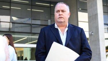 Alleged whistleblower cop Rick Flori leaves the Brisbane Supreme Court.