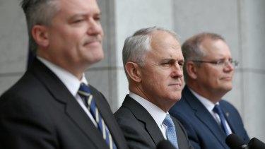 The money team: Finance Minister Mathias Cormann and Treasurer Scott Morrison, with Malcolm Turnbull.
