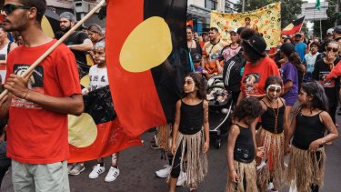Protesters march through Redfern on Australia Day to protest celebrating on that date.