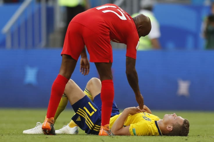Respect: England's Fabian Delph  comforts Sweden's Viktor Claesson after the quarterfinal match.