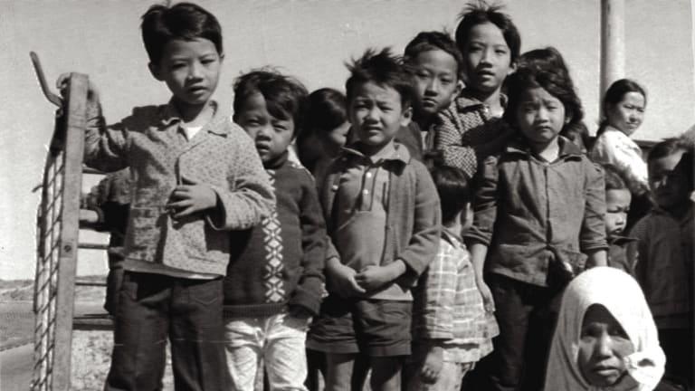 Vietnamese refugees arrive in Australia.