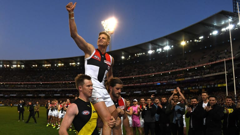Riewoldt is chaired off the ground by his cousin Jack and teammate Josh Bruce.