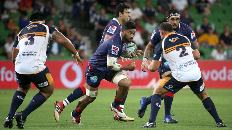 Amanaki Mafi of the Rebels takes on Allan Alaalatoa (left) and Josh Mann-Rea of the Brumbies.