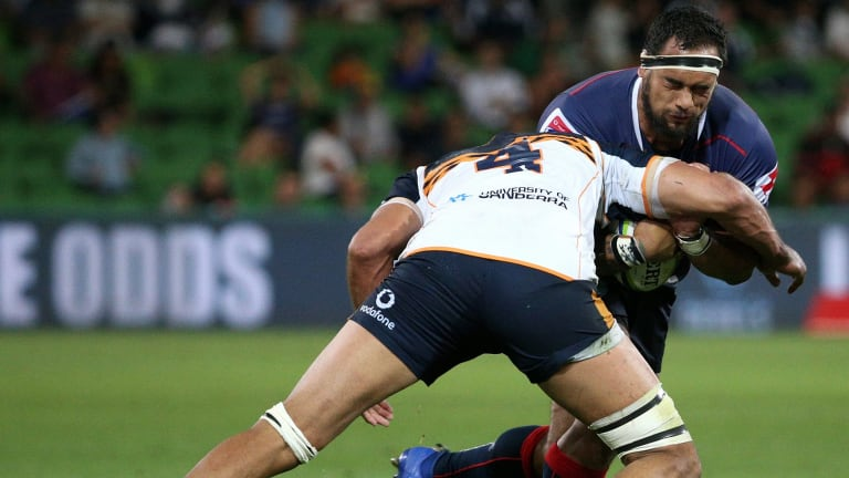 Tetera Faulkner of the Rebels is tackled by Rory Arnold of the Brumbies.