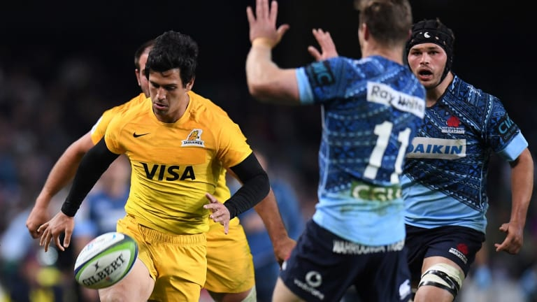 Cheeky: Matias Moroni of the Jaguares chips the ball over Cameron Clark in last year's clash.