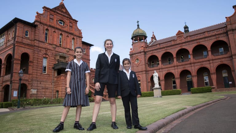 Santa Sabina College students Matilda Ball, Grace Campbell and Sophie Graham sport the new uniforms.