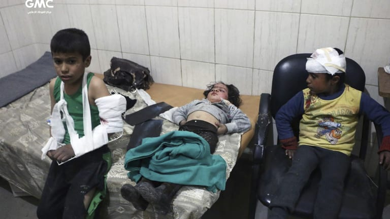 Children receiving treatment at a hospital in Hazeh in eastern Ghouta, Damascus, Syria, on Monday.