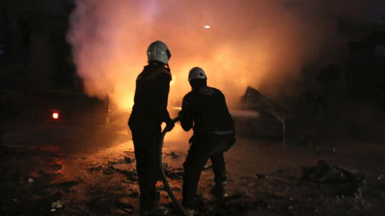 Syrian White Helmet civil defence workers extinguishing a fire following a bombing that targeted the office of Ajnad al-Koukaz, a militant group, in Idlib, Syria.