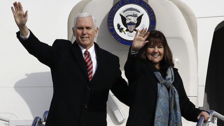 US Vice-President Mike Pence, left, and his wife Karen wave as they depart for South Korea. The US doesn't want the Games to be 'hijacked by North Korean propaganda'.