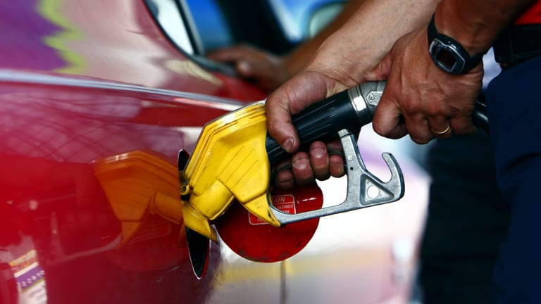 The first report into petrol margins shows Brisbane residents paid an average extra 3.3 cents per litre - or $50 million per year - for the past eight years.