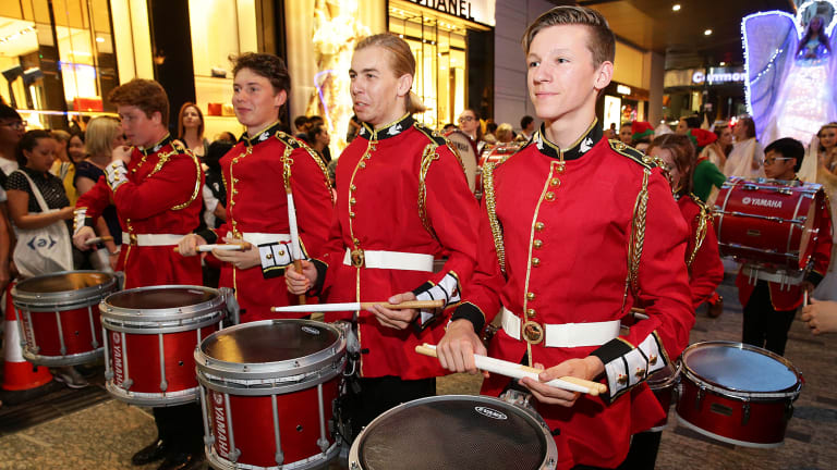 The drummer boys announce the arrival of the Christmas Parade in Queen Street Mall.