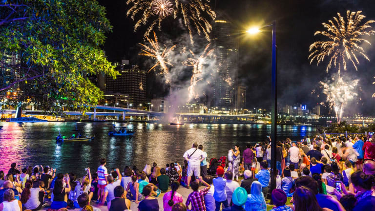 Crowds at South Bank watch  the New Year's Eve fireworks.