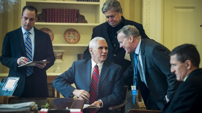 Seven out of 12 top staff have left, including every person surrounding Vice President Mike Pence in this 2017 photo.