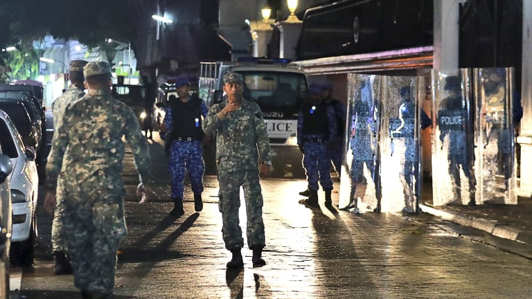 Maldives defence soldiers patrol on the main street of Male, Maldives.