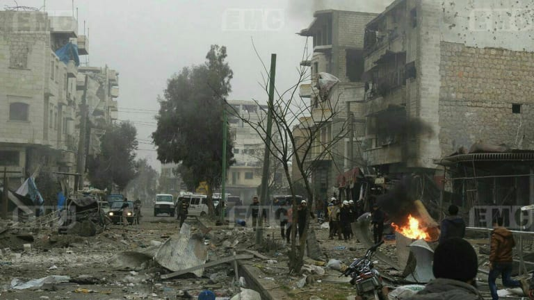Members of the Syrian civil defense known as the White Helmets, gathering at a street which was attacked by Russian airstrikes, in Maarat al-Nuaman town, southern Idlib province, Syria.