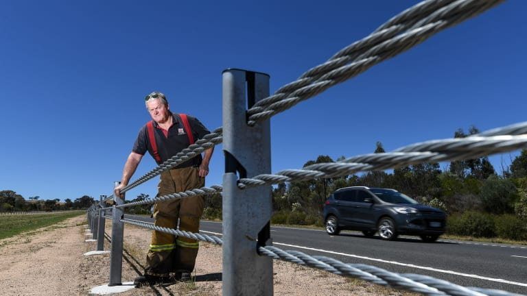 Captain Andy Chapman from Elphinstone CFA next to wire barriers on the Calder Freeway.