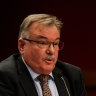 icare CEO John Nagle under fire at a parliamentary hearing.