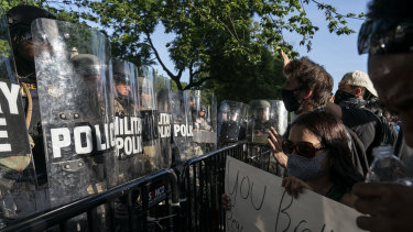 Protesters yell at military police during a demonstration in Washington, DC.