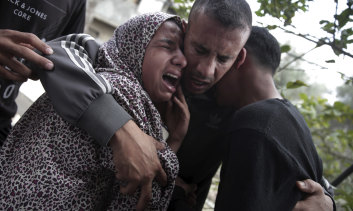 Relatives of 40-year-old Palestinian Jaber Abu Mustafa attend his funeral in the town of Khan Younis in the Gaza Strip. He was killed after Israeli troops fired live bullets across the border fence into Gaza during a protest.