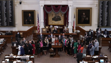 In May, Texas state representatives stand in the Texas House Chamber as they oppose a bill introduced that would allow private citizens to enforce an anti-abortion law  through civil lawsuits.