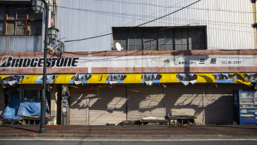 An abandoned bicycle shop in Namie, a town too close to the ill-fated Fukushima nuclear plant.