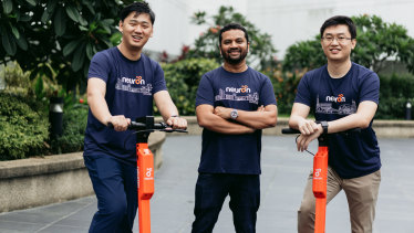 Neuron Mobility co-founders Zachary Wang, left, and Harry Yu, right, with Square Peg partner Tushar Roy.