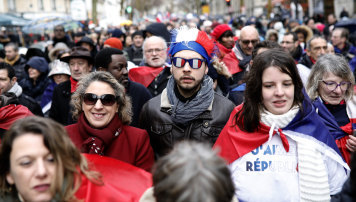 'Red scarves' protesters in Paris on Sunday.