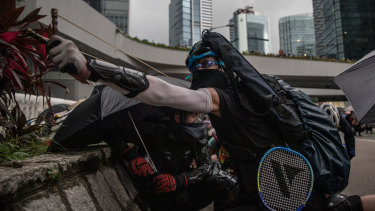A protester uses a sling shot outside the Central Government Complex.