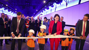 Federal Urban Infrastructure Minister Alan Tudge cuts the ribbon on the NorthConnex tunnel on Friday as NSW Premier Gladys Berejiklian and Transport Minister Andrew Constance watch on.