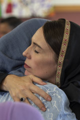Jacinda Ardern comforts a member of Christchurch's Muslim community just after the attack.