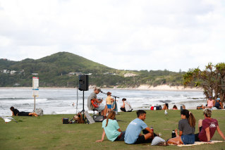 Byron Bay locals on Friday, after the annual Bluesfest was cancelled due to a local coronavirus transmission.