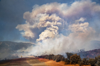 A large smoke plume fills the sky as the Apple fire burns out of control in Cherry Valley, California during August.